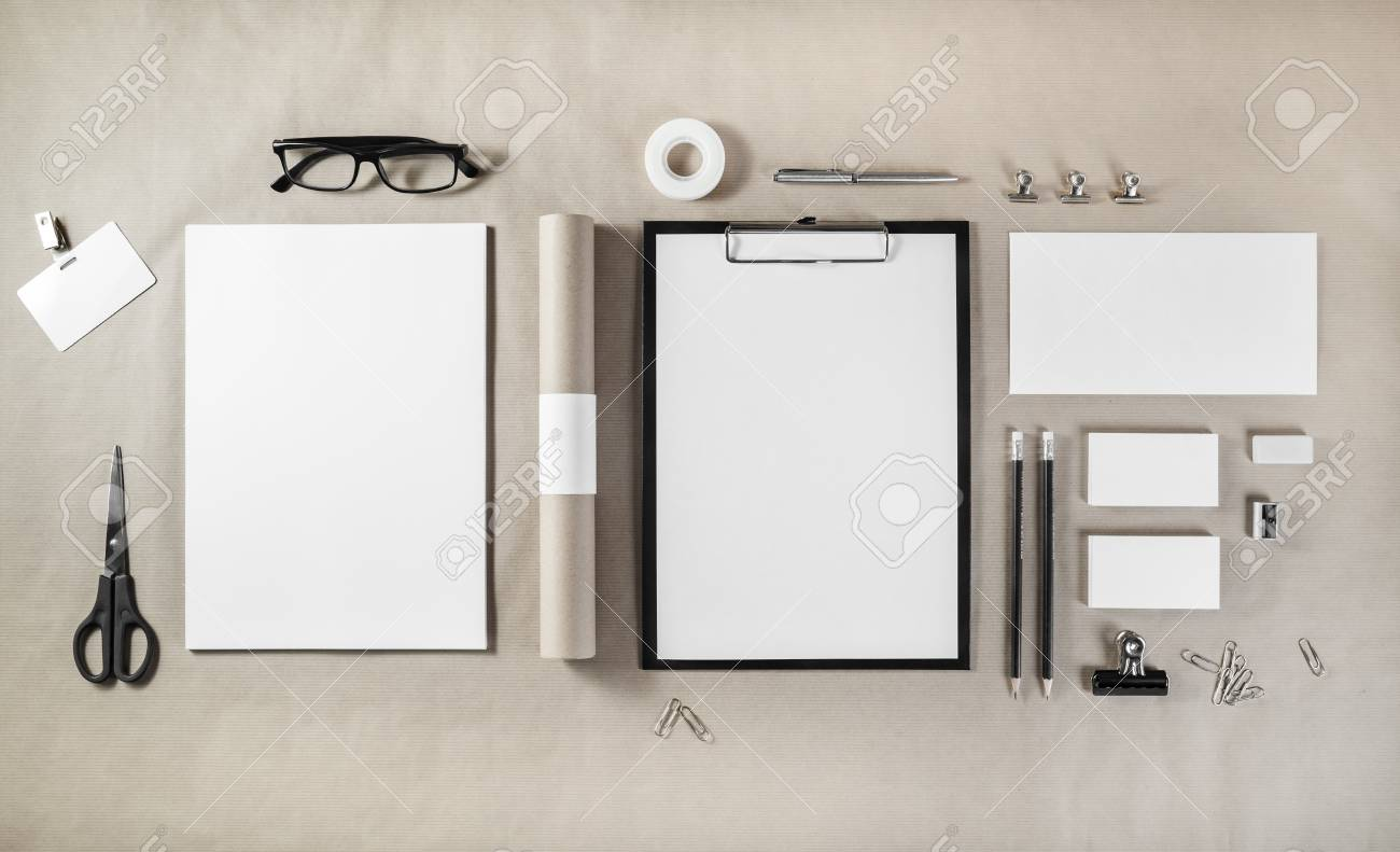 photo of blank stationery set on craft paper background responsive