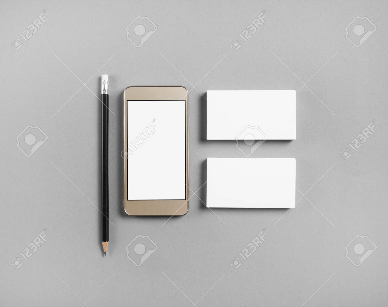 Mockup of blank business cards pencil and cellphone with blank mockup of blank business cards pencil and cellphone with blank screen at gray paper background colourmoves