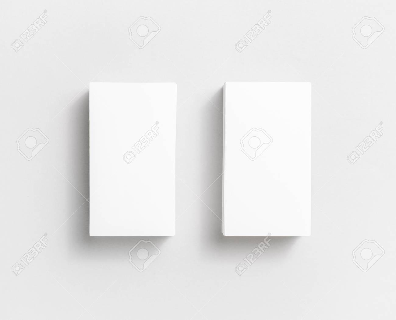 Photo Of Blank White Paper Business Cards On Paper Background ...