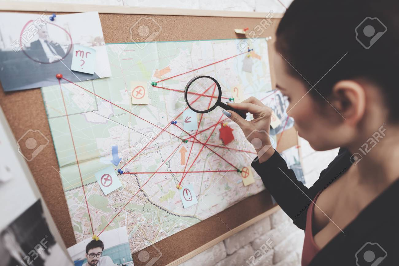 detective agency. Woman in jacket is looking at clue.. on the dead zone map, the ring map, the dark crystal map, braveheart map, the truman show map, chess map,
