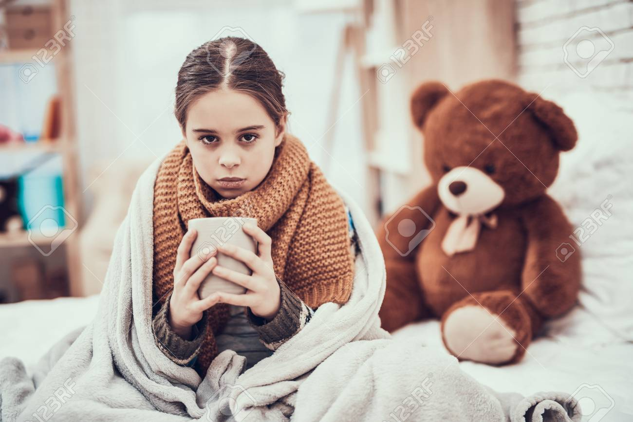 Little girl with cold in scarf and blanket with hot beverage stock little girl with cold in scarf and blanket with hot beverage in hands near teddy bear altavistaventures Images