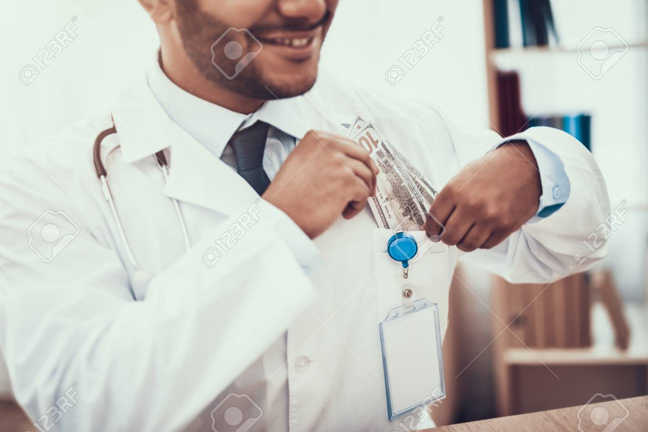 Indian Doctor In White Gown Seeing Patients In Office. Mother ...