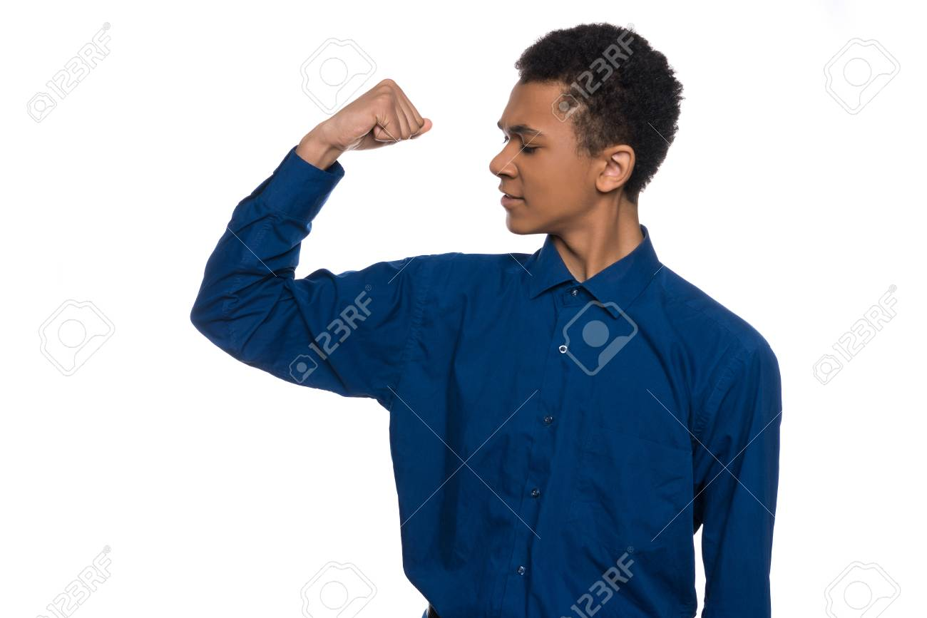 African American Teenager Shows Muscles On Arm Isolated On White