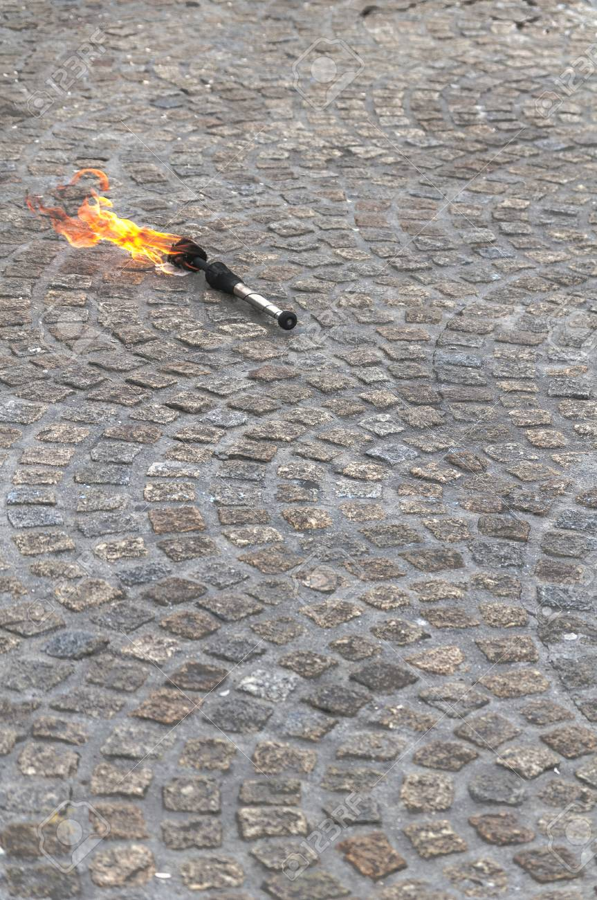 Image result for burning torch on ground