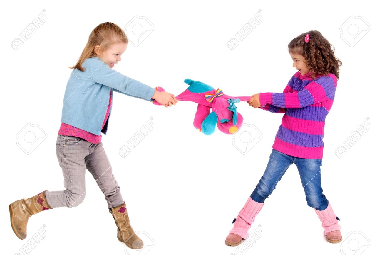 Two Girls Fighting Over A Toy Stock Photo