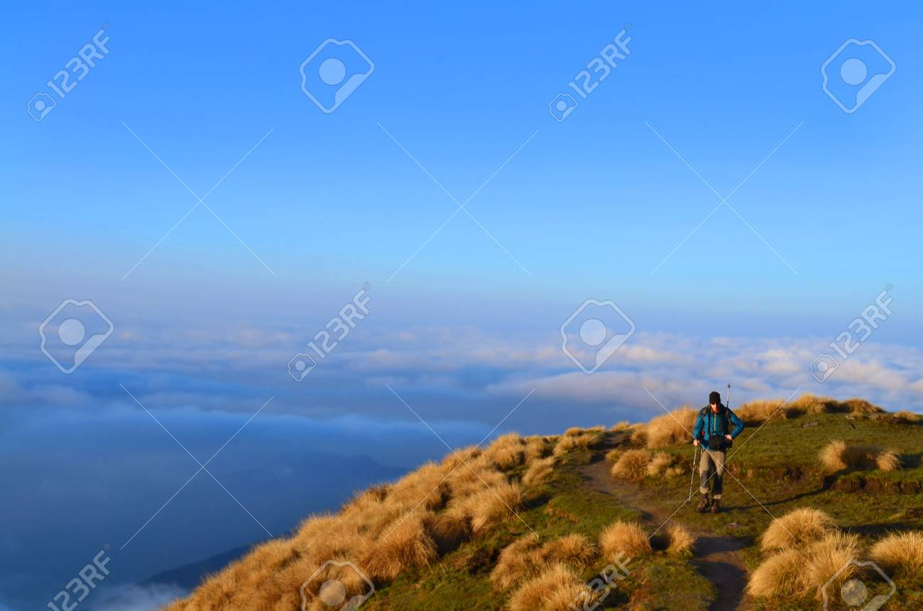 Single Traveler Man Above The Clouds Mountain Landscape In