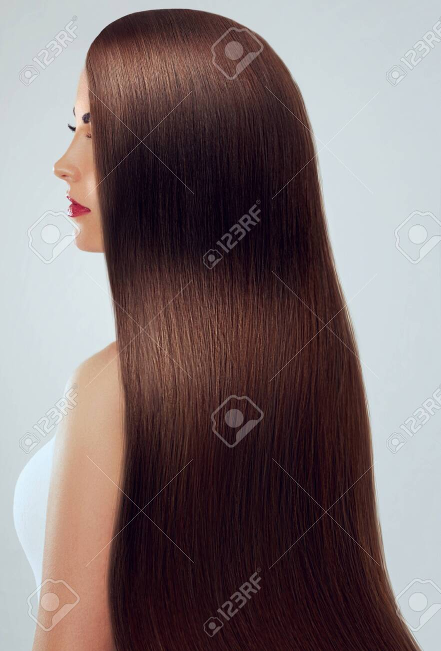 Beautiful Hair. Beauty woman with luxurious long hair. Beauty Model Girl with Healthy brown Hair. Pretty female with long smooth shiny straight hair. Hairstyle. Keratin straightening. - 129019451