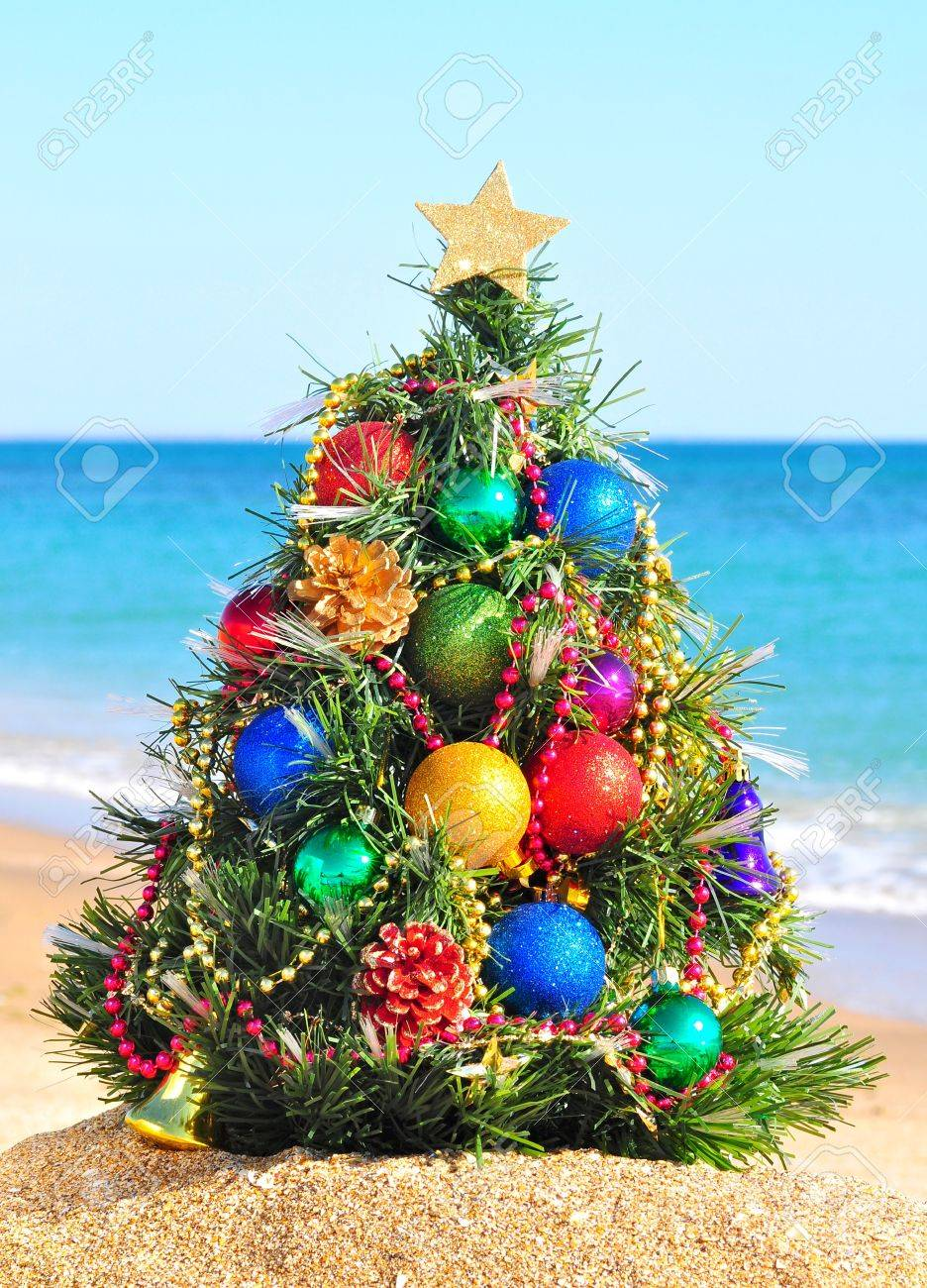 Christmas tree on the sand in the beach - 16019422
