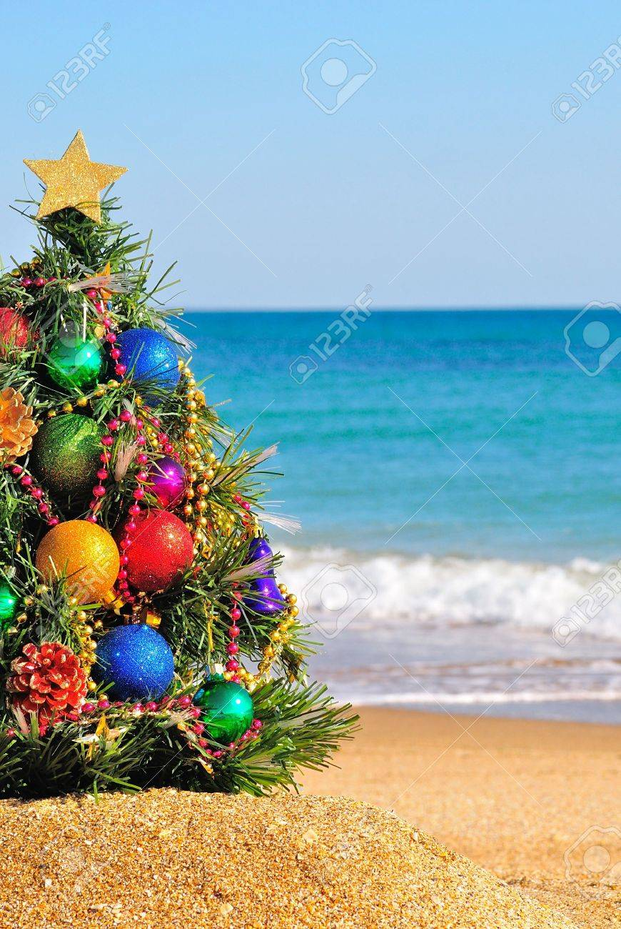 Christmas tree on the sand in the beach - 16606234