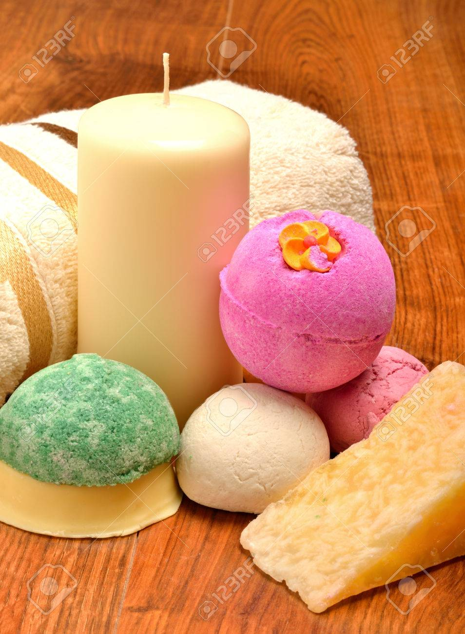 Candle, soap, bath bombs and bath towel on the wooden background - 26819238