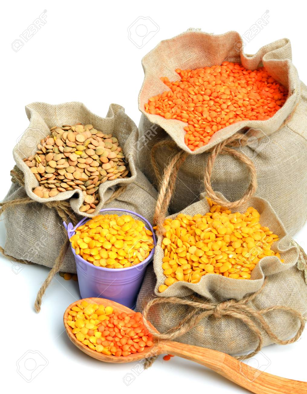 green, red and yellow lentils in the sacks and spoon wooden isolated on white background - 36968775