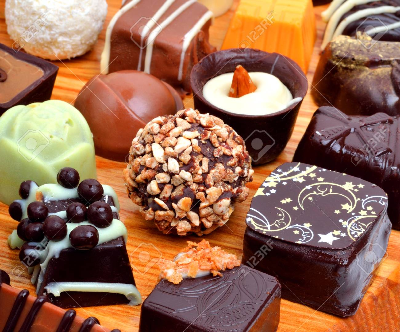 Assortment of various chocolate sweets isolated on white - 41303179