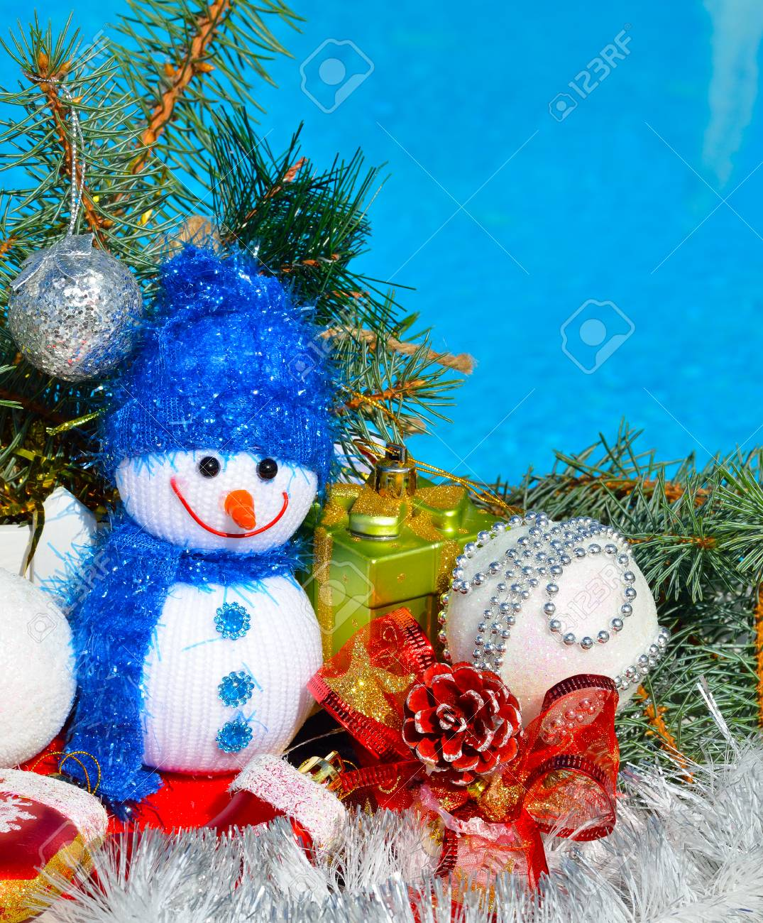 snowman christmas decorations and pine branch opposite the pool stock photo 48548118