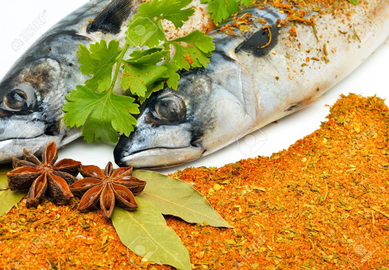 Mackerels with spices, parsley and bay leaf. - 60807703
