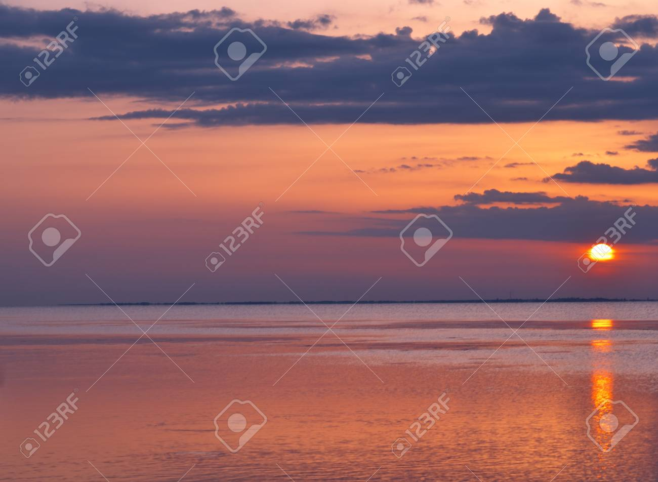 Sunset on the beach over sea in the summer, landscape. - 60807706