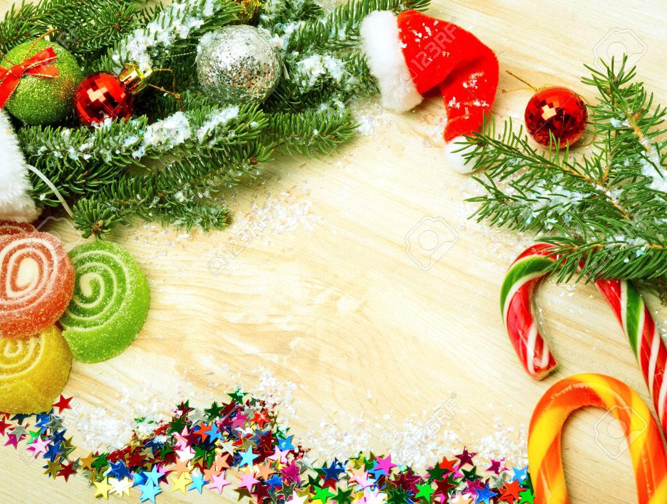 Christmas background, lollipops, pine twig, sweets, jellies - 67644195