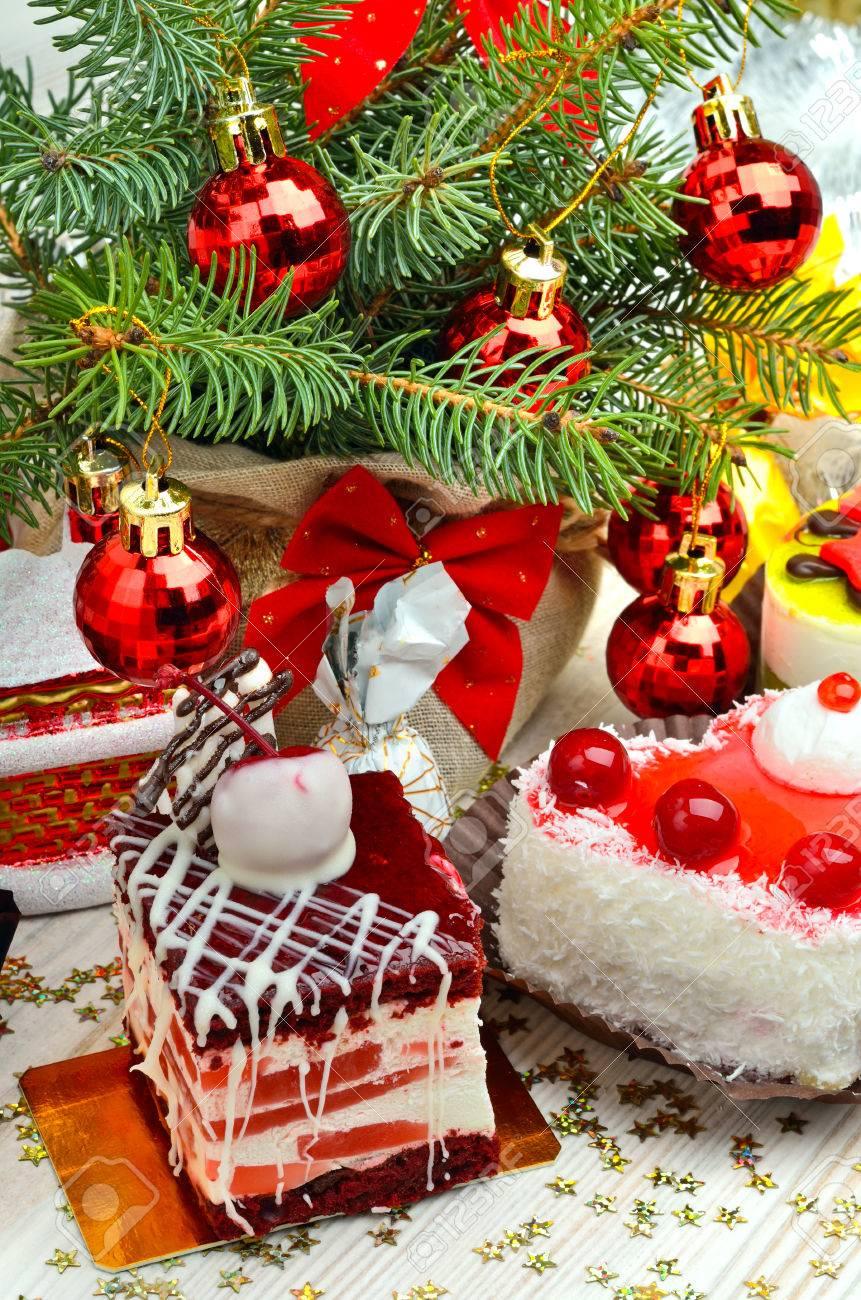 Christmas cakes on christmas background, christmas balls, pine twig. - 67643972