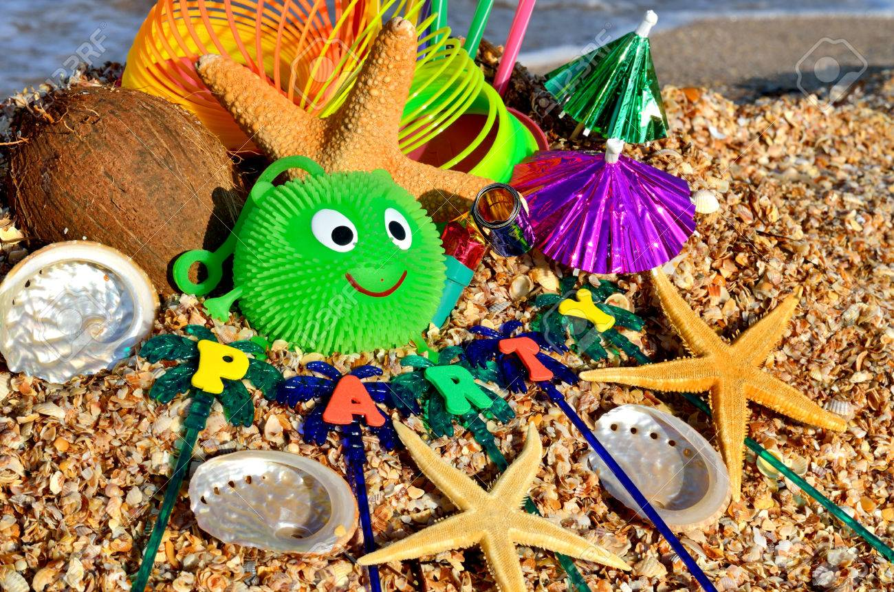 Party decorations on the beach. Starfish, shells, candies, coconut, and tubules. - 68693462