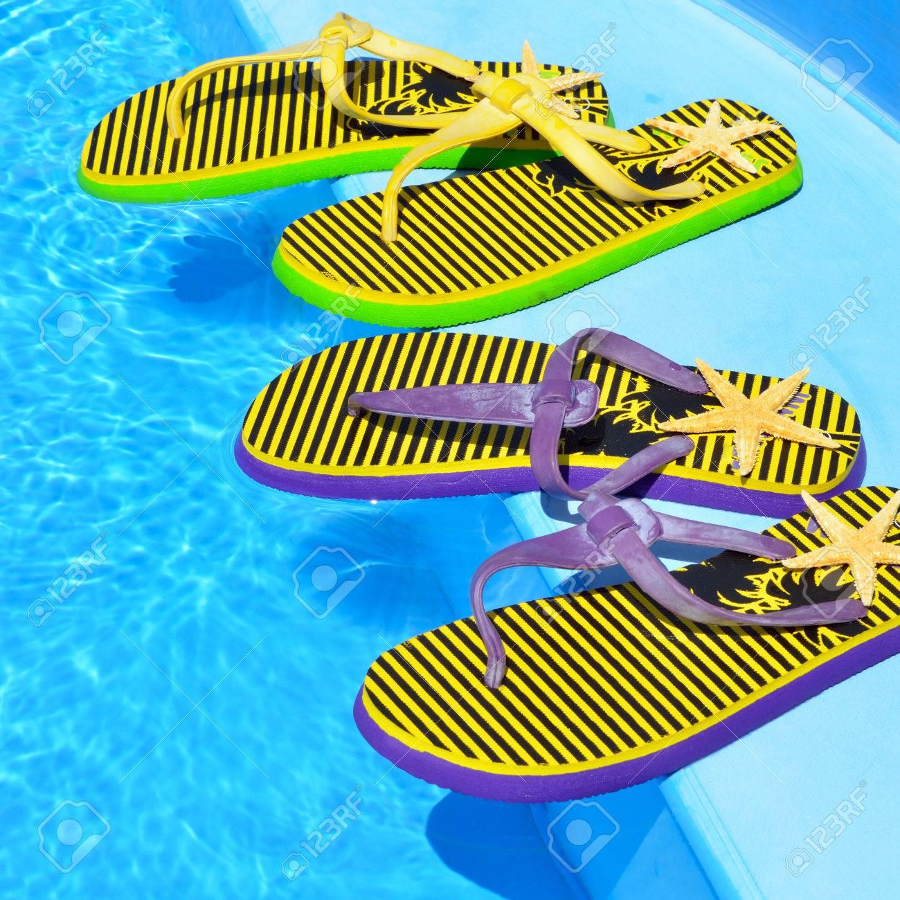 Flip-flops on the swimming pool. - 67008006