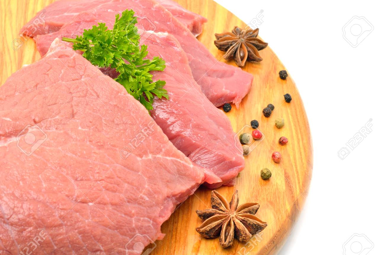 Raw meat with parsley on cutting board isolated on white - 71998273