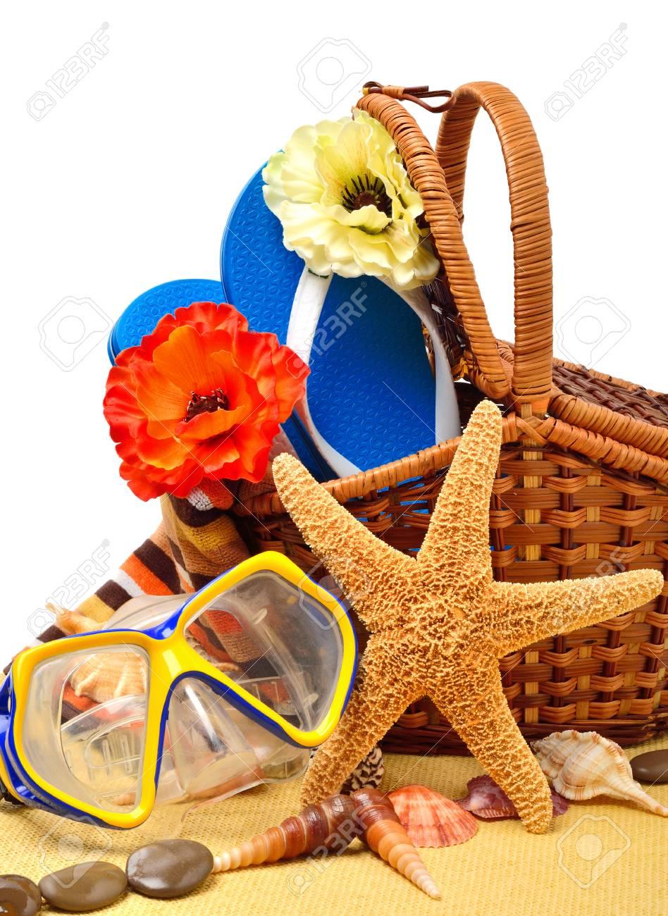 Flip-flops, fishstar, wicker basket, goggles isolated on white. - 77274275