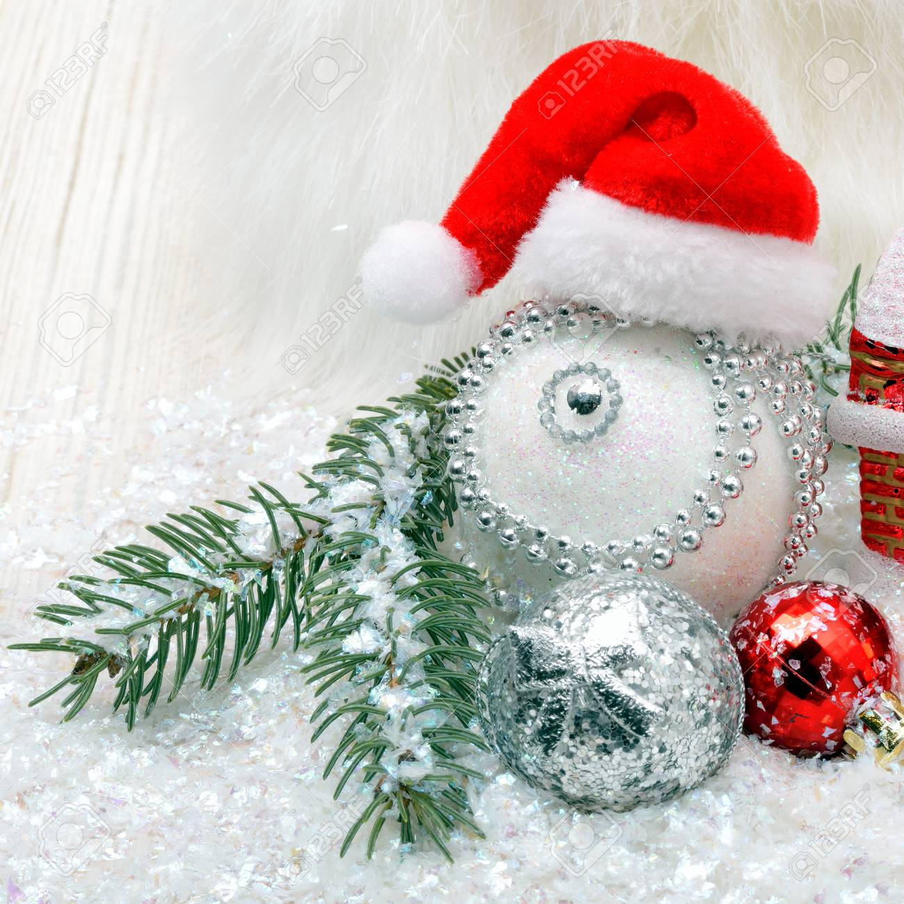 Christmas background with snow, christmas baubles and pine twigs - 90739474