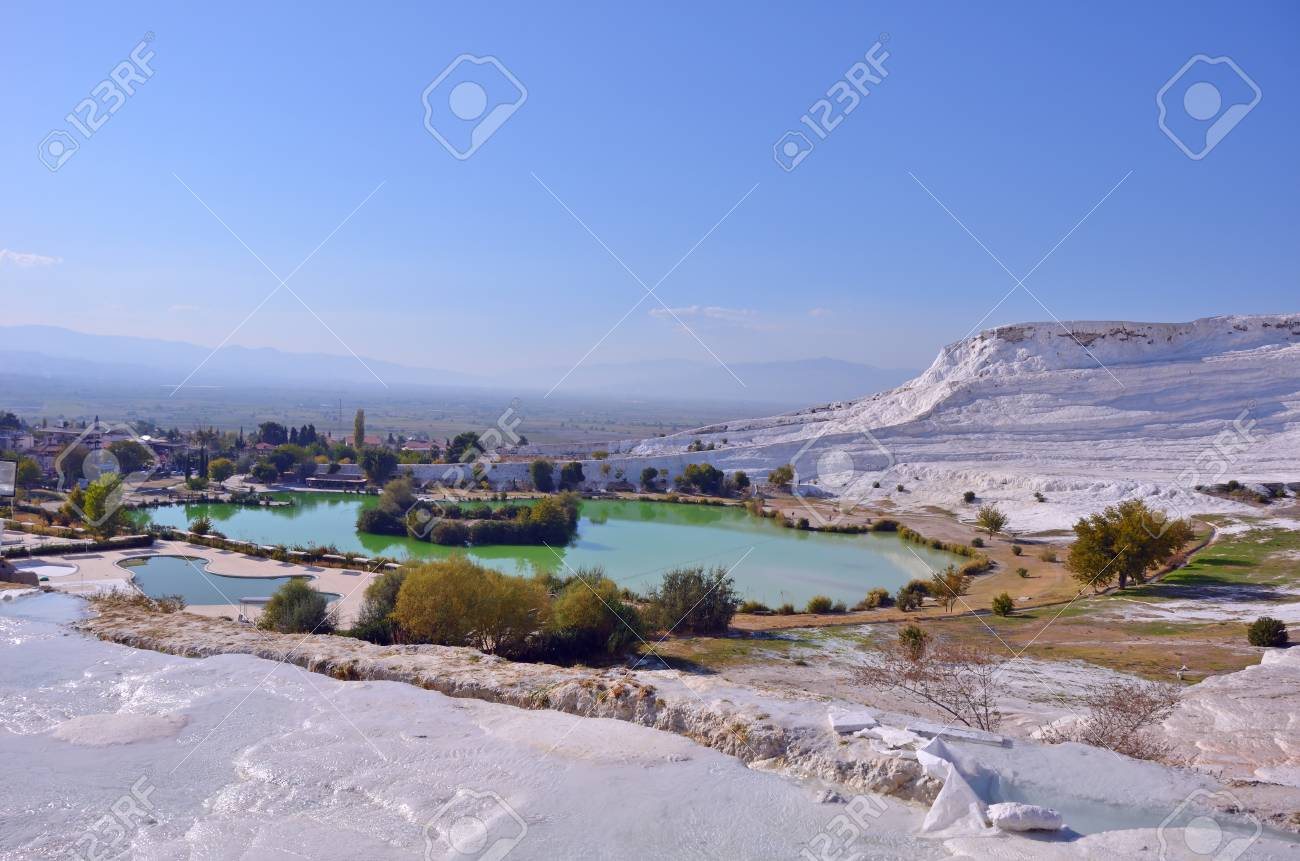 Travertine pools and terraces in Pamukkale, Turkey in a beautiful autumn day. - 90677723