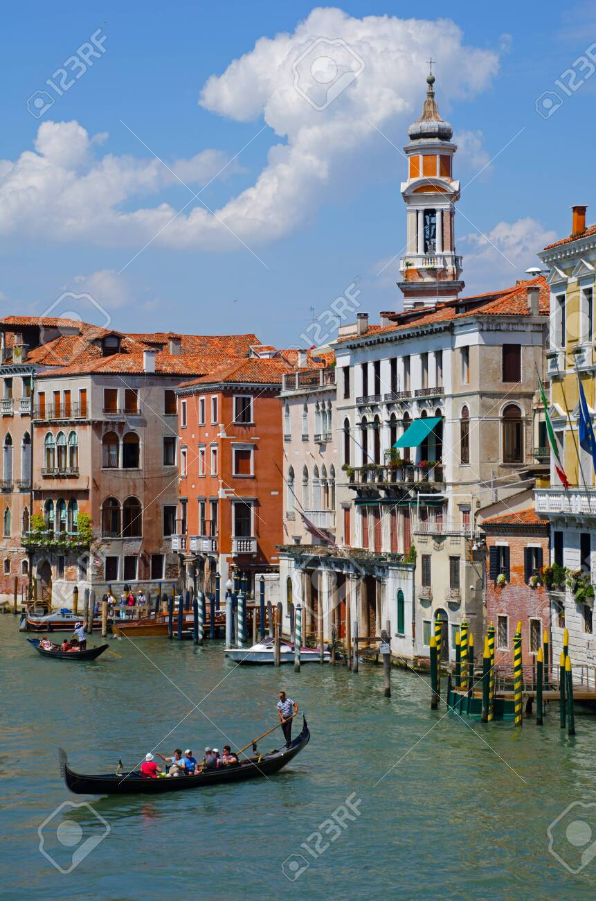 "Venetian gondoliers punting gondolas through ""canal grande"" in Venice, Italy. - 121736322"