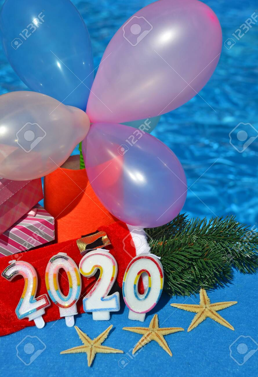 Christmas decorations and pine branch 2020, on the background of the pool. - 137887463