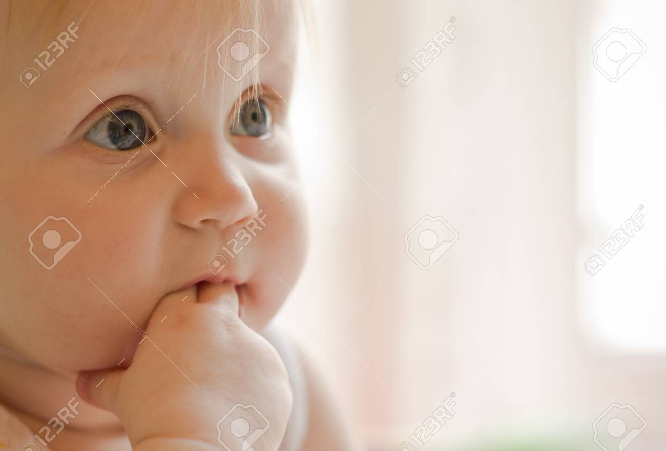 Portret of little  girl with fingers in a mouth Stock Photo - 9362121