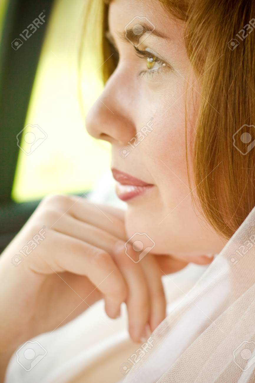 Beautiful young bride in the car Stock Photo - 9530897
