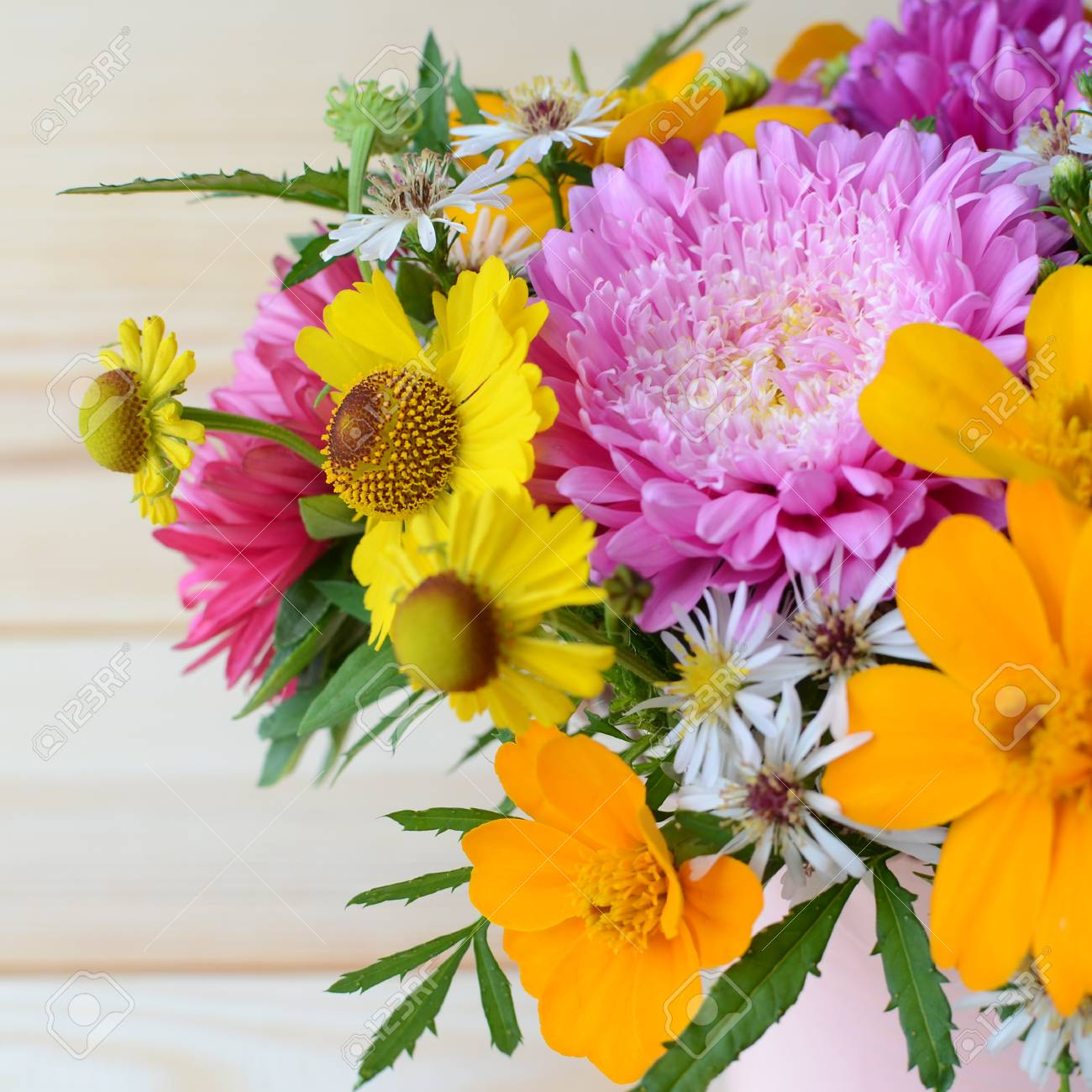 Multi colored bouquet of different autumn flowers on a wooden multi colored bouquet of different autumn flowers on a wooden background stock photo 63356595 izmirmasajfo