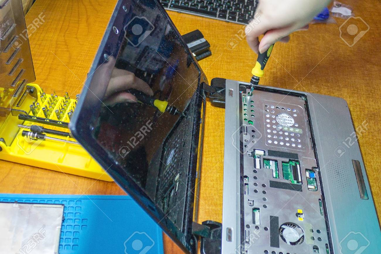 The process of removing the case from the laptop, repairing the