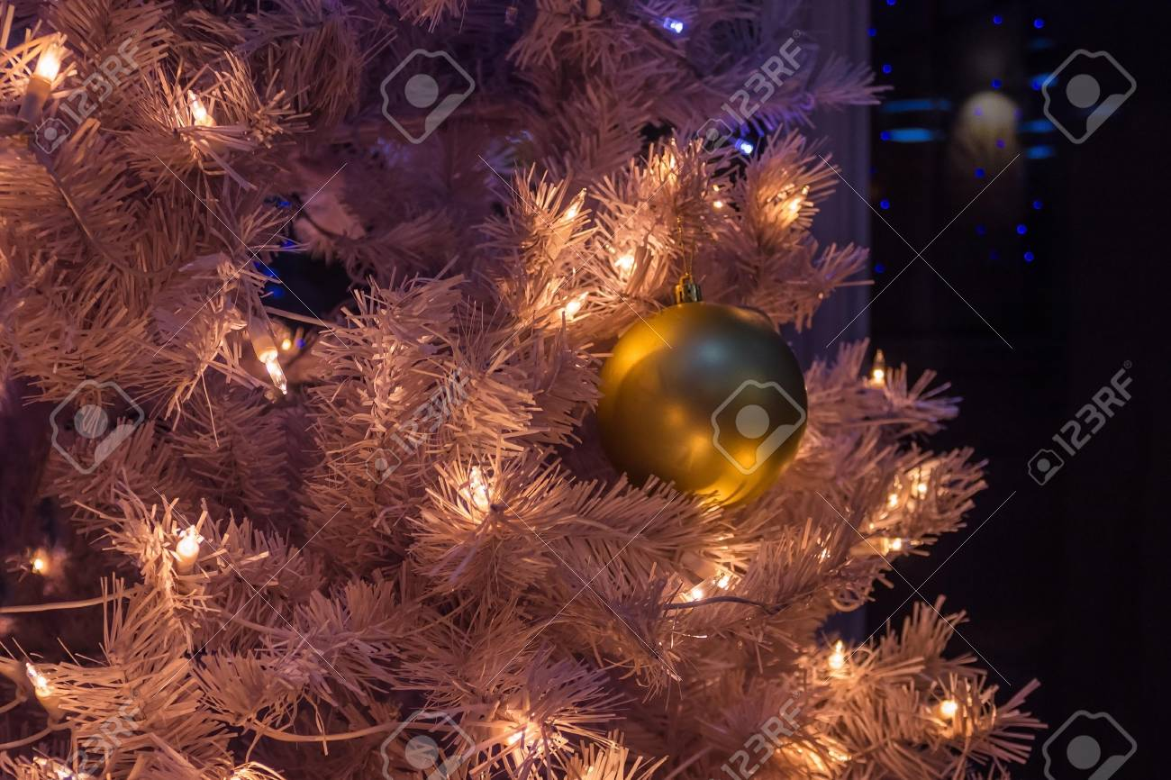 new year background decorated shimmering christmas tree on the branches are white lights