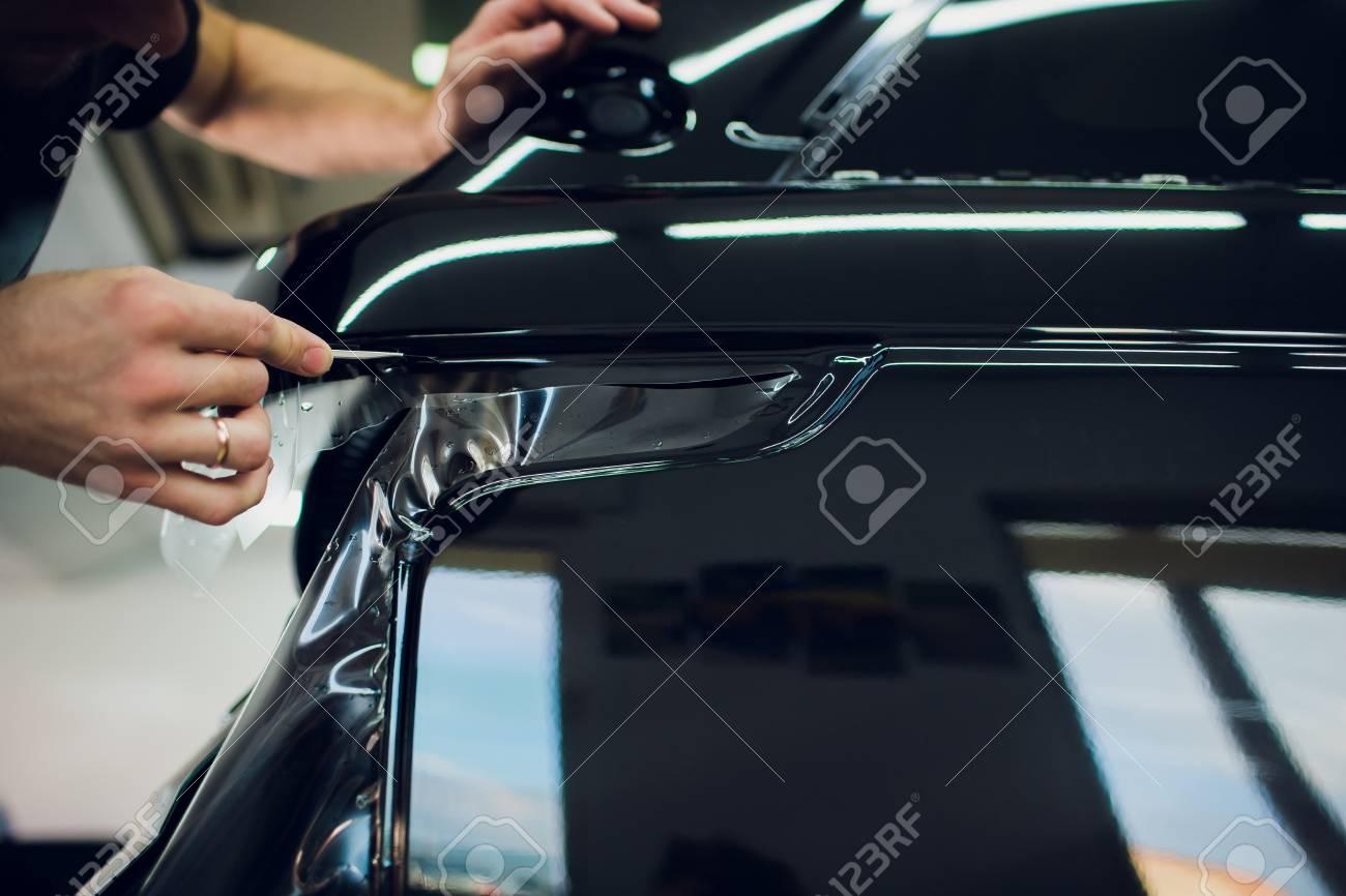 Car Paint Protection >> Worker Hands Installs Car Paint Protection Film Wrap