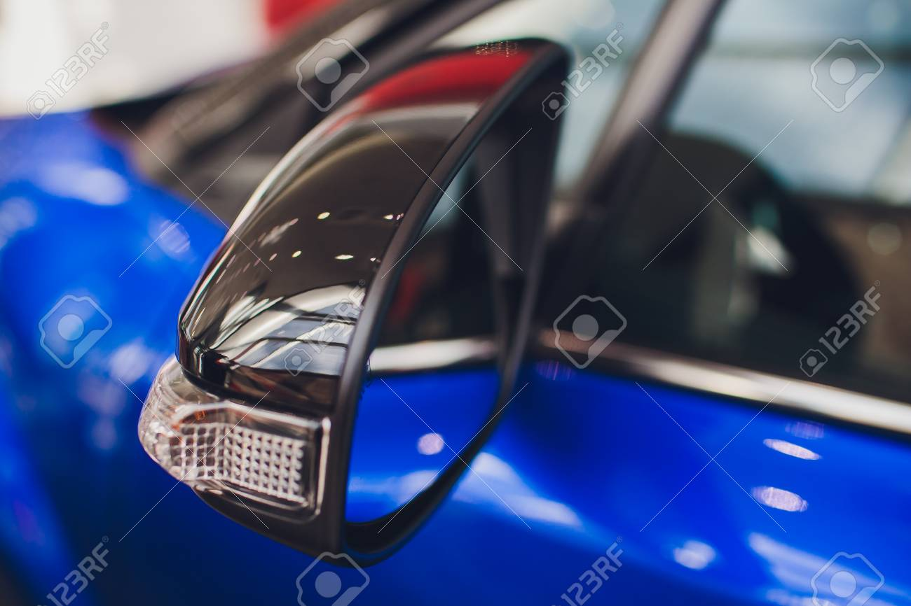 side rear-view mirror on modern car - 115321116