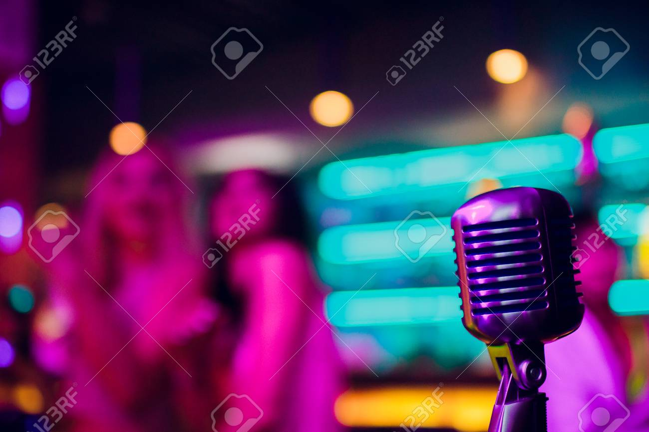 microphone on a stand up comedy stage with reflectors ray, high contrast image - 114254338