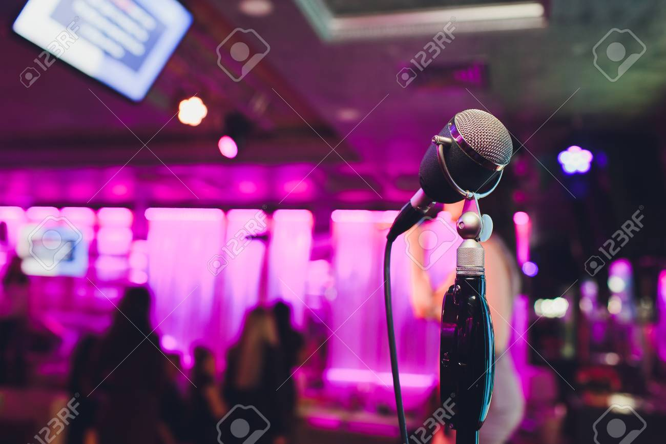 Retro microphone against blur colorful light in pub and restaurant background. - 120738125