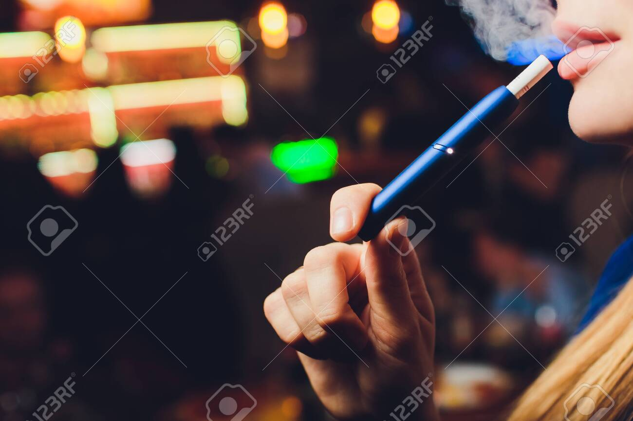 New design. Showcase with a large multi-colored selection System of heating of tobacco. Color devices for smoking. New technology of electronic cigarettes. heating of tobacco. - 120897199