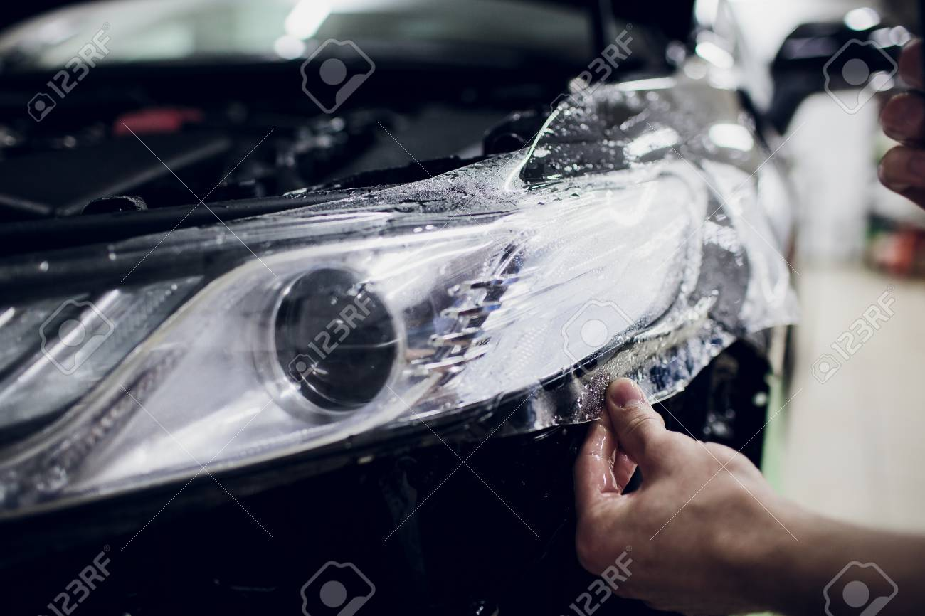 Paint Protection Film >> Worker Hands Installs Car Paint Protection Film Wrap Auto Headlight