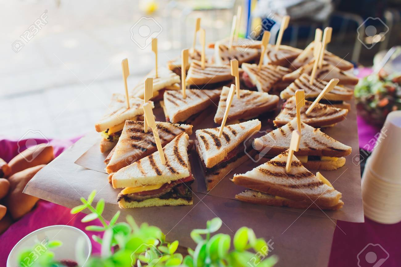 Cut platter of mixed sandwich triangles, on the buffet table - 124644757