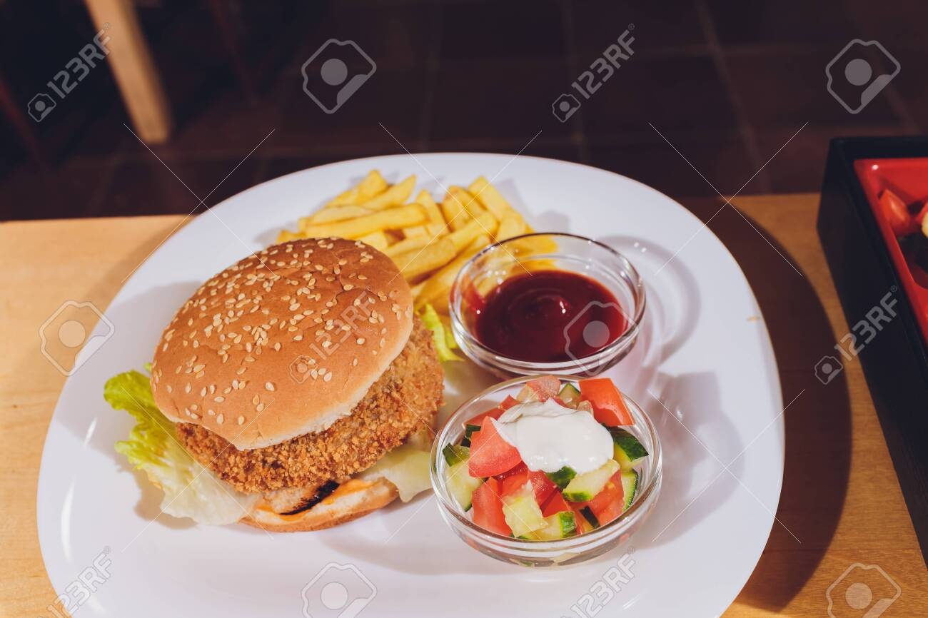 Mini Burger Platter With Fries Salad On The Table Stock Photo Picture And Royalty Free Image Image 135880474
