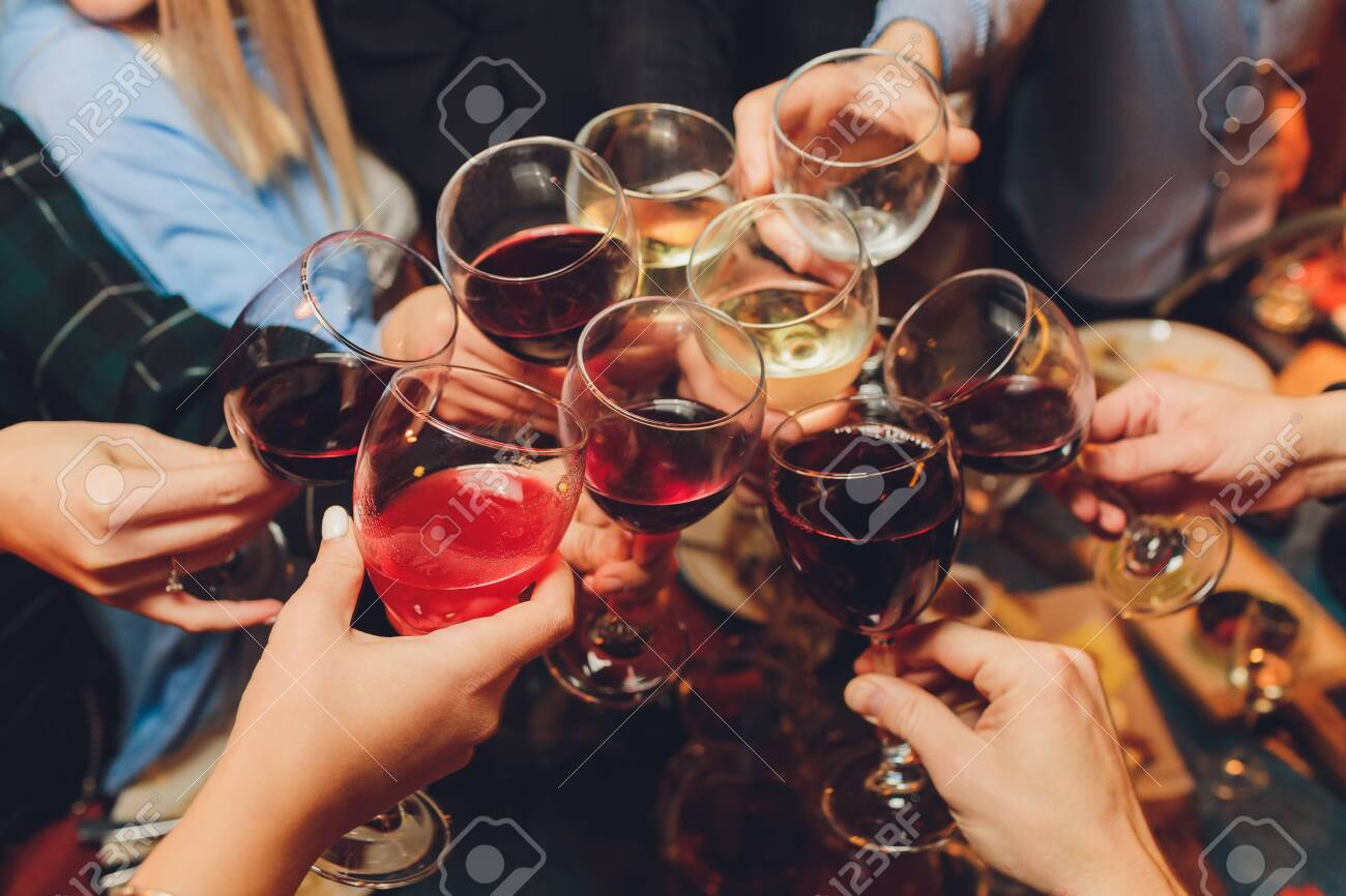 Close up shot of group of people clinking glasses with wine or champagne in front of bokeh background. older people hands. - 138223070