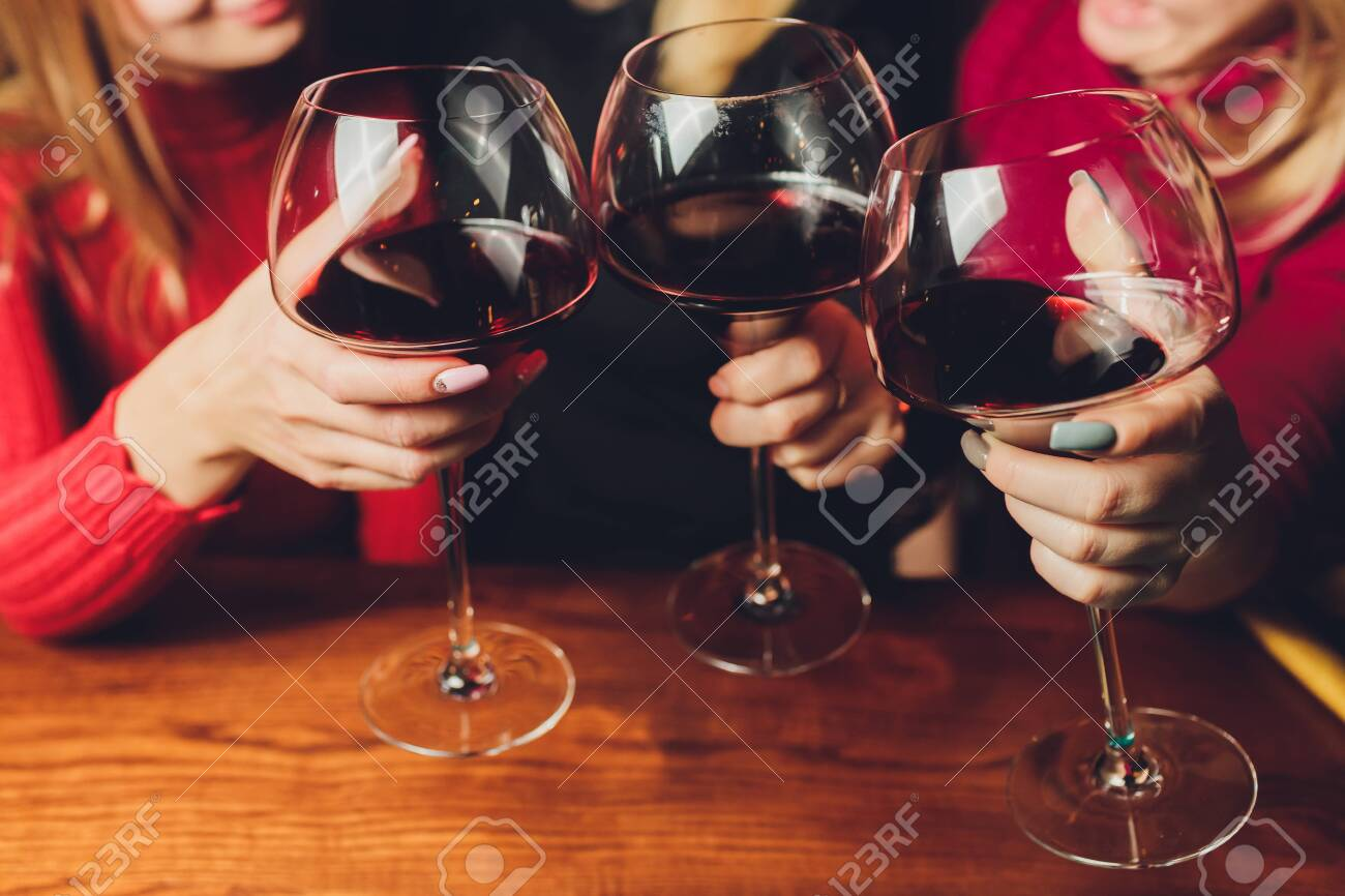 Clinking glasses with alcohol and toasting, party - 139852773