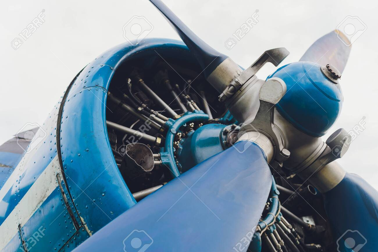 Close up view of a vintage propeller passenger and cargo airplane. - 151898712