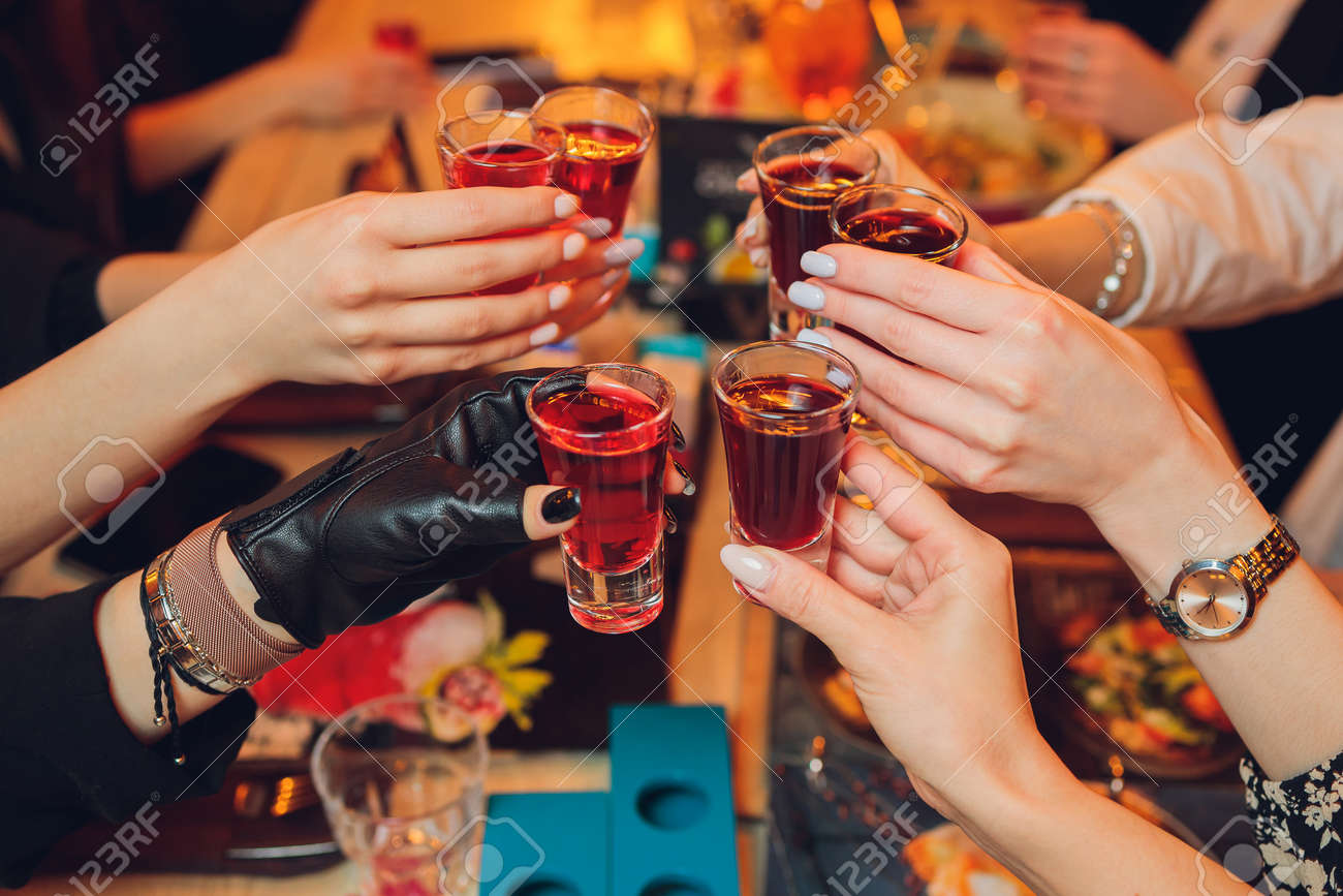 Clinking glasses with alcohol and toasting, party. - 167131892
