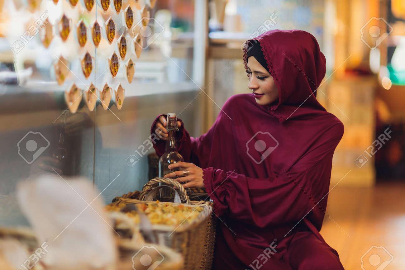 Arabian young muslim woman sitting in a cafe. - 169483490
