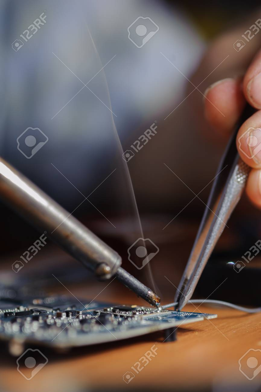 Closeup Of Soldering Iron Tool And Tweezers Electrical Engineer Printed Circuit Board Device With A Equipment Stock Photo 67100867