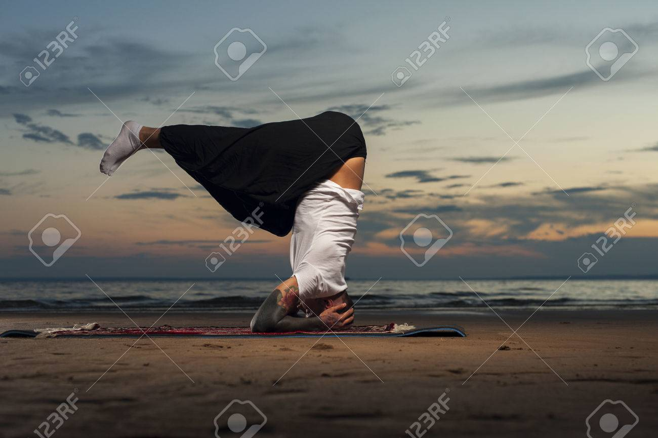 Fit Tattoo Man Practicing Yoga On The Beach Head Stand Pose Stock Photo Picture And Royalty Free Image Image 67043130