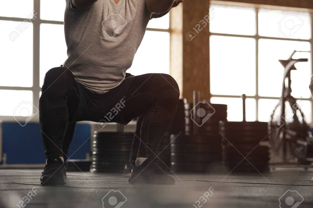 Close-up - Young Man Working Out in Gym. - 120849569
